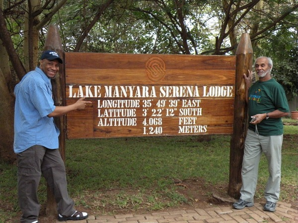 Kenny and Charles at Lake Manyara sign
